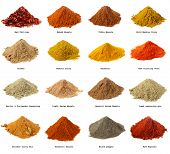 pic of garam masala  - sixteen piles of Indian powder spices with its names isolated on white - JPG
