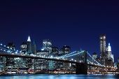 stock photo of new york night  - Brooklyn Bridge and Manhattan Skyline At Night - JPG