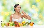 people, diet, healthy eating and food concept - happy woman drinking water from glass with fruits an poster