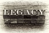 legacy  word in mixed vintage metal type printing blocks over grunge wood, black and white image poster