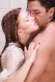 stock photo of early 20s  - Loving affectionate young heterosexual couple in affectionate sensual kiss after taking shower - JPG
