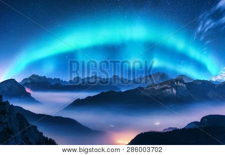 Aurora Borealis Above Mountains In