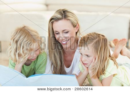 Mother reading story for her children