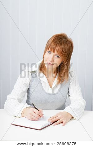 Attractive Girl With A Notepad And Pen