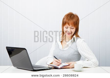 Smiling Attractive Girl With A Notebook