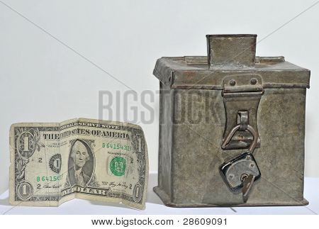 old steel money box with padlock and dollar
