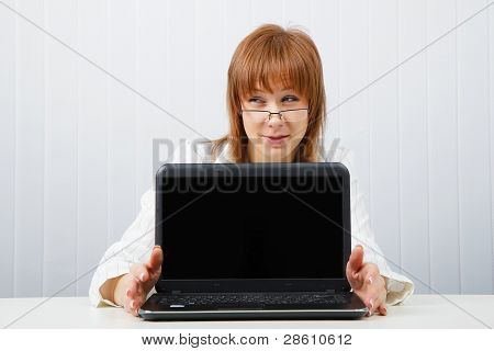 The Girl Shows The Laptop