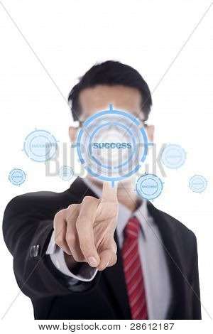 Businessman Touching the Success Key