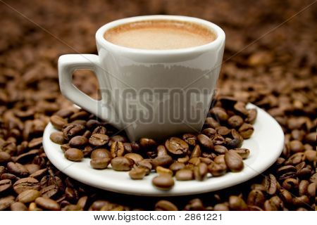 Espresso On Coffe Beans