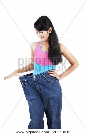 Asian Woman Wearing An Old Jeans