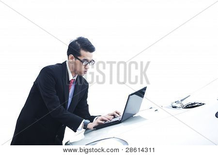 Businessman With Laptop On The Car