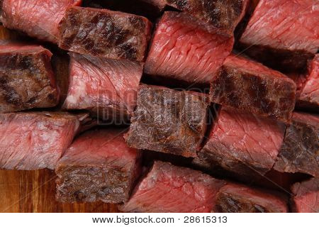 american meat : big rare roast steak on wood isolate on white background
