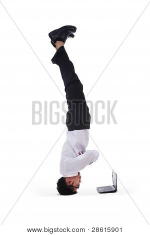 Isolated Businessman Headstand With Laptop