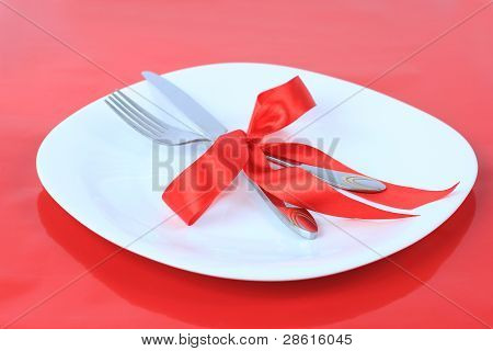 Romantic Dinner on red background. Place setting for Valentine's