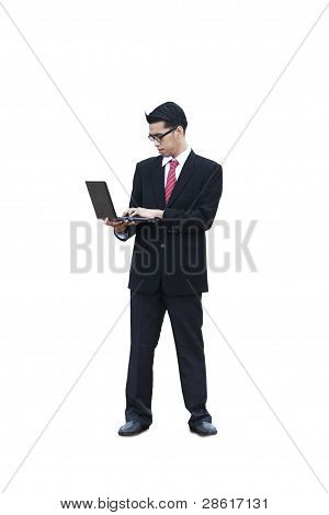 Standing Businessman Using Laptop