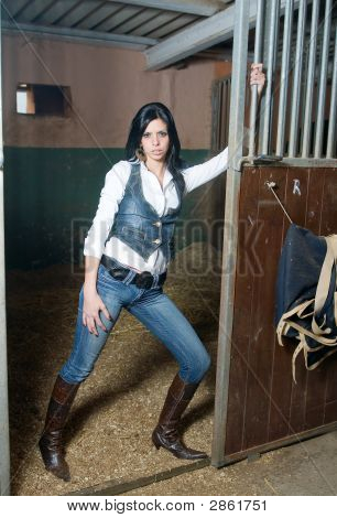 Girl With Jeans In A Farm