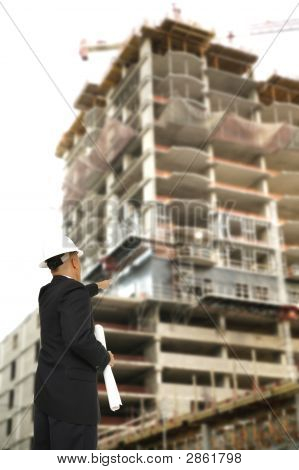 Designer Pointing At Construction Building