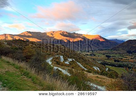 Perspective of Highway Road Freeway  to Arrow Town with Sunrise Mountain Landscape New Zealand