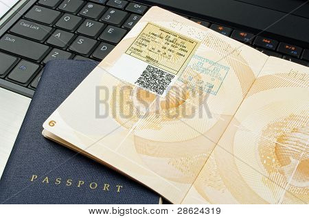 open passport and laptop
