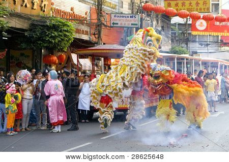 Lion And Dragon Dance At Chinese New Year Celebration In Bangkok