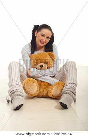 Woman With  Bear Toy On Floor