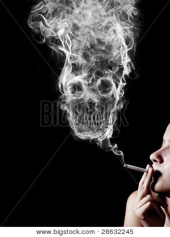 """woman smoking a cigarette. Of smoke formed skull dead, as a symbol of the dangers of smoking to health and imminent death of people. The concept """"smoking kills"""". Isolated on a black background"""