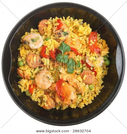 Paella ready meal with shrimp, chicken and chorizo.