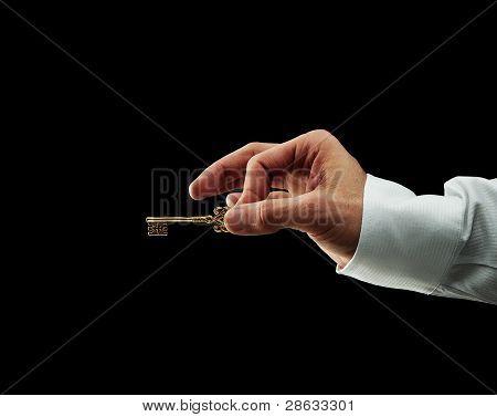 Human Hand holding golden key