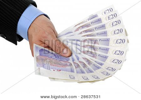Businessmans hand holding twenty pound notes against white background