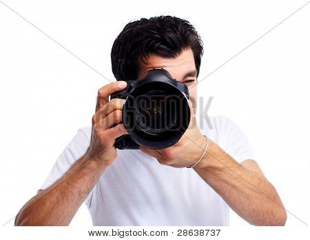 Young man with camera. Isolated over white background.