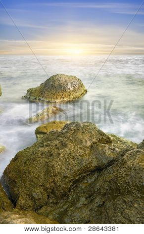 Ocean And Rock At The Sunset.