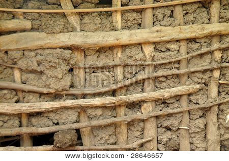 african Mut and wood hut facade texture