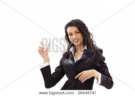 Happy young business woman pointing at something interesting against white background