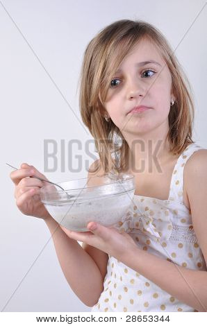 Thoughful Child With A Bowl Of Milk Porridge