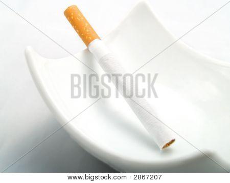 A Cigarette In Clean White Ashtray