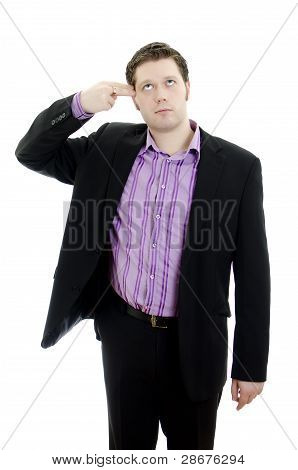 Portrait Of A Young Business Manputs Two Fingers To His Temple. Isolated Over White Background