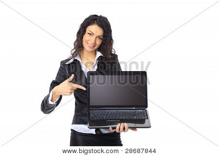 Brunette young businesswoman showing a laptop screen with copyspace