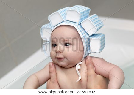 Baby Boy Having Bath In Swim Cap