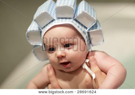 Baby Boy In Bath In Swim Cap