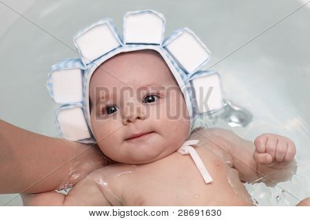 Baby Boy In Bath In Bathing Cap