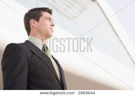 Business Man Standing Outside An Office
