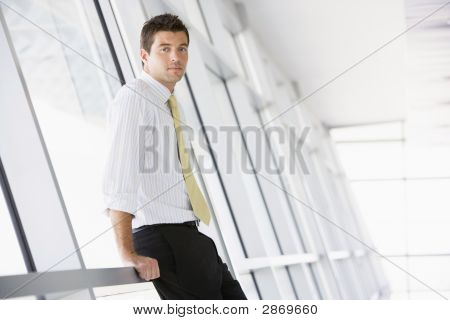 Businessman Standing In A Modern Office