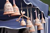 stock photo of loamy  - Clay souvenir bells decorated with paintings of Russian folk