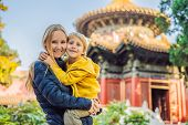 Enjoying Vacation In China. Mom And Son In Forbidden City. Travel To China With Kids Concept. Visa F poster