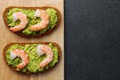 Shrimp And Guacamole With Bread On Dark Background poster