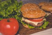 Нamburger Or Sandwich On Brown Paper. Delicious Sandwich Hamburger With Meat, Cheese And Fresh Veget poster