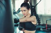 Sporty Boxer Is Exercise Punching In Fitness Gym.,portrait Of Boxing Woman Is Practicing Footwork In poster