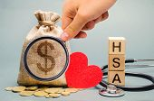 Wooden Blocks With The Word Hsa And Money Bag With Stethoscope. Health Savings Account. Health Care. poster
