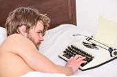 Writer Use Manual Typewriter Daily Work. Man Writer Lay Bed Working On New Book. New Day Brings Fres poster