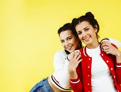 Lifestyle People Concept: Two Pretty Young School Teenage Girls Having Fun Happy Smiling On Yellow B poster